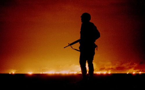 - FILE PHOTO 26FEB91 - A file photo dated February 26, 1991 of a U.S. soldier standing night guard a..